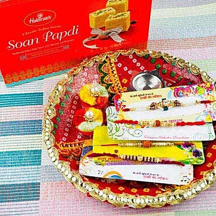 Four Rakhi Set With Soan Papdi and Traditional Thali
