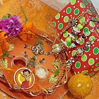 Family Rakhi Set Of Four Thali With Boondi Laddu: Rakhi and Sweets to Canada