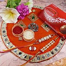 Golden Rakhi Set Of Two Thali With Lindt lindor: Rakhi with Chocolates to Canada