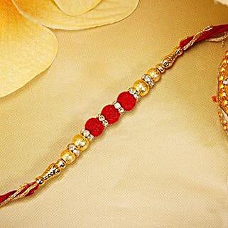 Gold And Red Velvet Beads Rakhi: Rakhi Delivery in Colombia