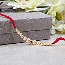 Off White Pearl Rakhi: Send Rakhi to indonesia