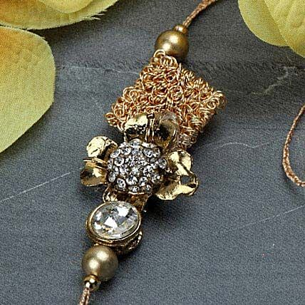 Delightful Antique Rakhi ITA