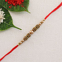 White Moti Rajwadi Rakhi Thread: Rakhi Delivery in Italy