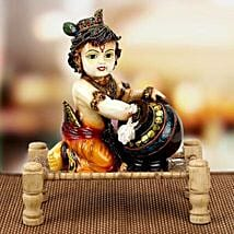 Bal Krishna With Matki on Charpai: Send Handicraft Gifts for Him