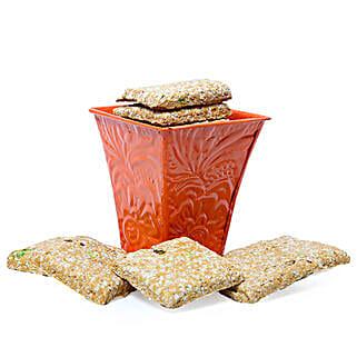Gur Til Chikki In Orange Vase: Gifts for Lohri