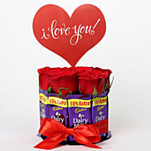 Red Roses in Glass Vase & Dairy Milk Arrangement: Chocolates for Valentines Day