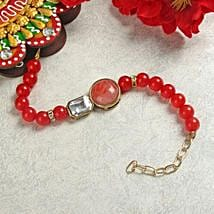 Ruby Bracelet Rakhi: Rakhi to Ambernath