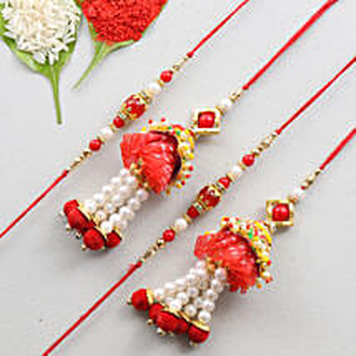Set Of 4 Glittering Rakhis- Designer & Lumba: Send Rakhi for Bhaiya Bhabhi