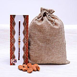 Glittering Rakhi With Almond Nuts: Rakhi with Dryfruits to New Zealand