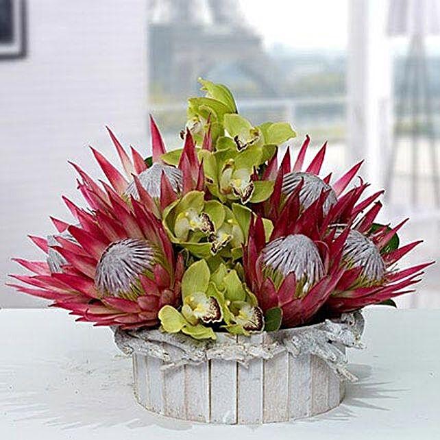 Splendid Protea N Cymbidium Flower Arrangemnt