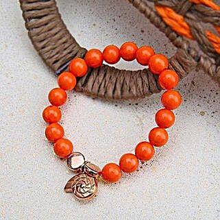 Alluring Orange Beaded Rakhi: Send Rakhi to Fujairah