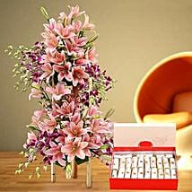 Appealing Flowers Arrangement and Kaju Roll Combo: Mother's Day Flower and Sweets to UAE
