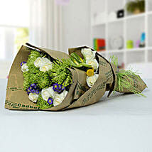 Delicate Flower Bouquet In Newspaper Packing: Send Flower Bouquets to UAE