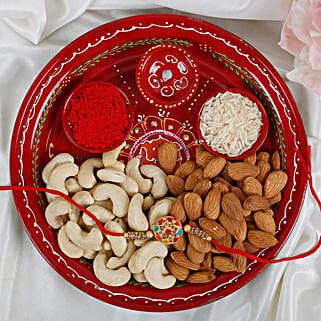 Premium Navrang Rakhi with Puja thali Dry fruits Rakhi Hamper: Send Rakhi With Dryfruits to UK