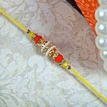 Sparkling yellow Thread: Rakhi for Brother - UK