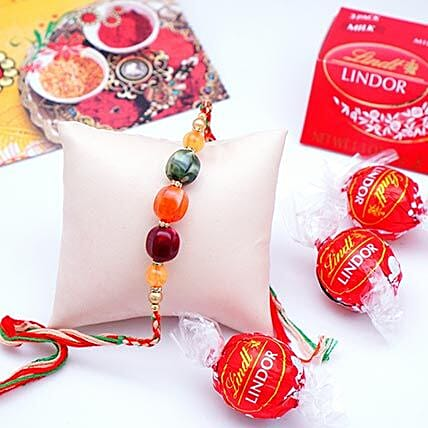 Designer Rakhi with Lindt Milk Truffles Pack