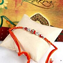 Glittering Maroon Rakhi Thread: Rakhi to Madison