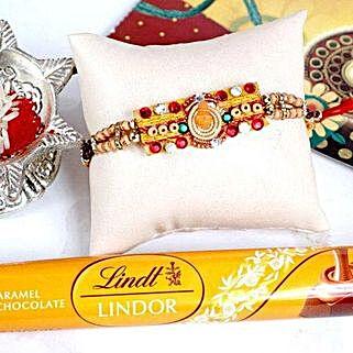 OM Kalash Rakhi with Lindt Caramel Bar: Send Rakhi & Chocolates to USA
